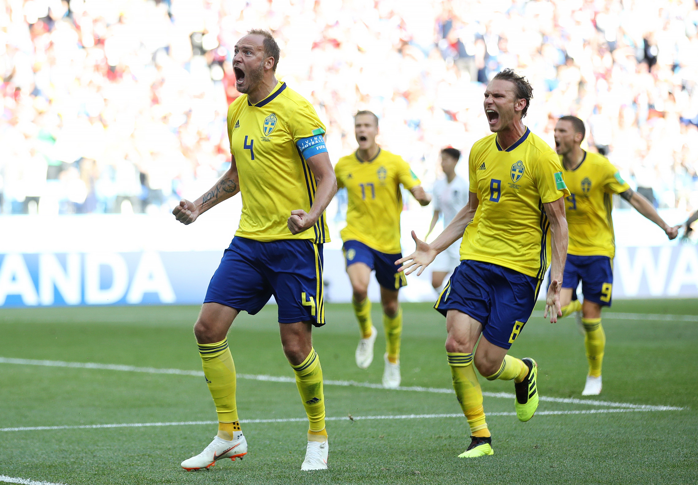 NIZHNIY NOVGOROD, RUSSIA - JUNE 18: Andreas Granqvist of Sweden (L) celebrates after scoring his team's first goal with team mate Albin Ekdal (R) during the 2018 FIFA World Cup Russia group F match between Sweden and Korea Republic at Nizhniy Novgorod Stadium on June 18, 2018 in Nizhniy Novgorod, Russia.