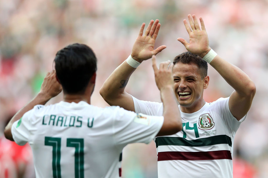 ROSTOV-ON-DON, RUSSIA - JUNE 23: Carlos Vela of Mexico celebrates with teammate Javier Hernandez after scoring a penalty for his team's first goal during the 2018 FIFA World Cup Russia group F match between Korea Republic and Mexico at Rostov Arena on June 23, 2018 in Rostov-on-Don, Russia. (