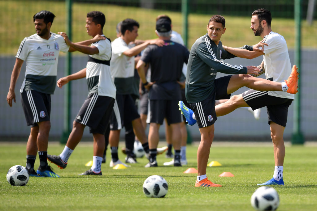 MOSCOW, RUSSIA - JUNE 29: Javier Hernandez and Miguel Layun of Mexico, warm up during a training at Training Base Novogorsk-Dynamo, on June 29, 2018 in Moscow, Russia.