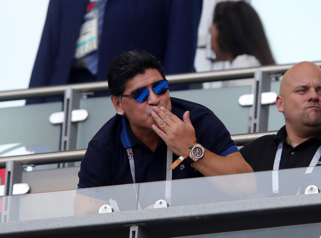 KAZAN, RUSSIA - JUNE 30: Diego Armando Maradona blows a kiss from the stands during the 2018 FIFA World Cup Russia Round of 16 match between France and Argentina at Kazan Arena on June 30, 2018 in Kazan, Russia.